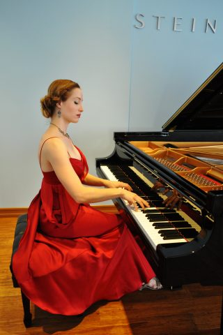 Danae Vlasse_performance photo_red dress Indieviews
